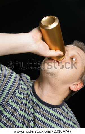Man with beer can over black background. Focus on the nearest can! - stock photo