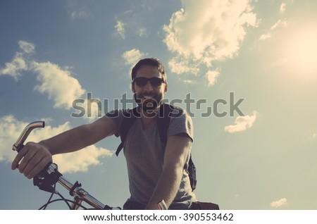 Man with bicycle having fun. retro style image. - stock photo