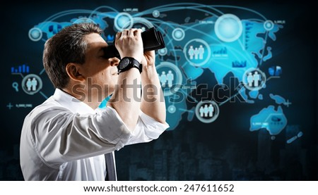 Man with binoculars Spying to business competitors. - stock photo