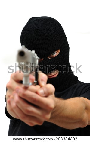 Man with black mask and blue eyes pointing a gun out of focus, Isolated on white - stock photo