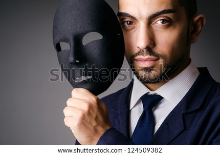Man with black mask in studio - stock photo