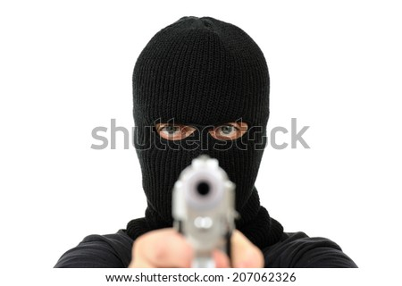 Man with black mask pointing a gun out of focus, Isolated on white - stock photo