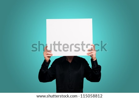 man with black shirt holding blank white board on blue background