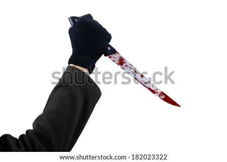 Man with bloody knife, hand close up, dark background - stock photo