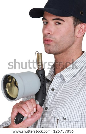 Man with blowtorch - stock photo