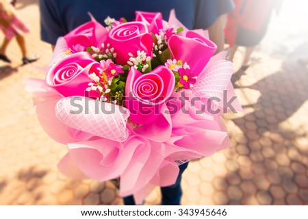 Man With Bouquet Flowers,Close Up person Holding or Giving Bouquet Flowers,Man Delivery Bouquet of Pink Roses Flowers - stock photo
