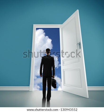 man with briefcase open door to blue sky