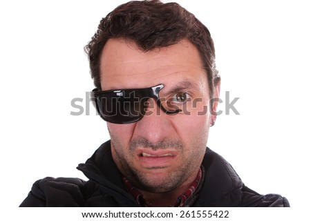 man with broken glasses - stock photo