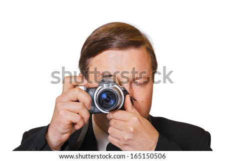 Man with camera isolated on white background - stock photo