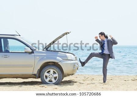 Man with car on seaside - stock photo