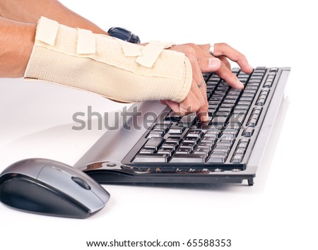 Man with Carpal Tunnel Typing - stock photo