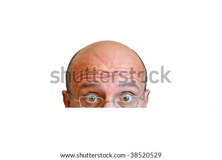 Man with cleanhead and glasses looking shocked into the camera - stock photo