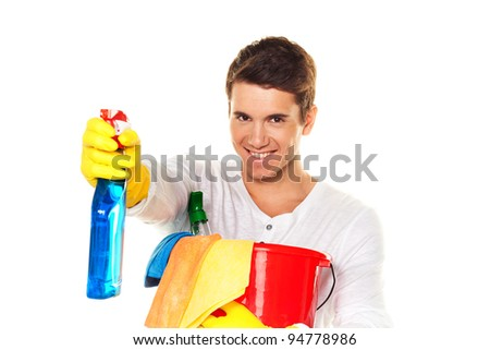 man with cleaning fluid. cleaning the apartment. hausmannbei apartment cleaning in the spring - stock photo