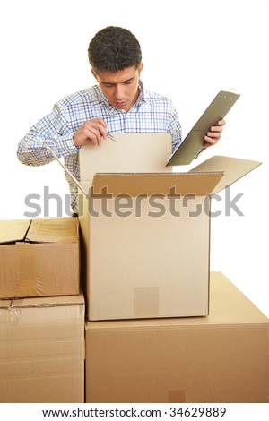 Man with clipboard counting the content of cardboard boxes - stock photo