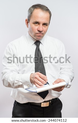 man  with clipboard in his hand - stock photo