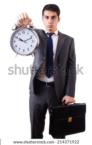 Man with clock afraid to miss deadline isolated on white - stock photo