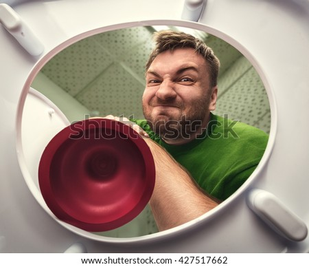 Man with cup plunger - stock photo
