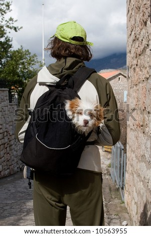 Man with dog in bag