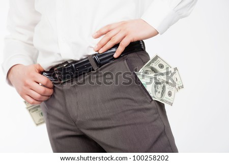 Man with dollars in pockets isolared on white - stock photo