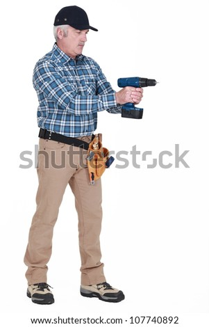 Man with drill - stock photo
