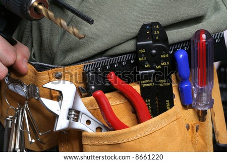 man with drill and tool belt - stock photo