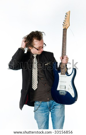 Man with electro guitar, studio shot - stock photo