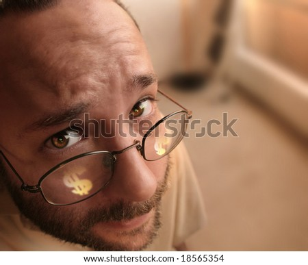 man with eyeglasses with dollar sign on the lenses - stock photo