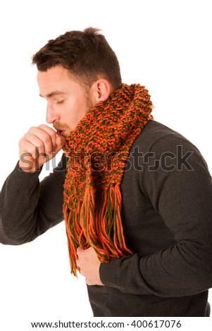 Man with flu and fever wrapped in scarf holding cup of healing tea and coughing isolated over white. - stock photo