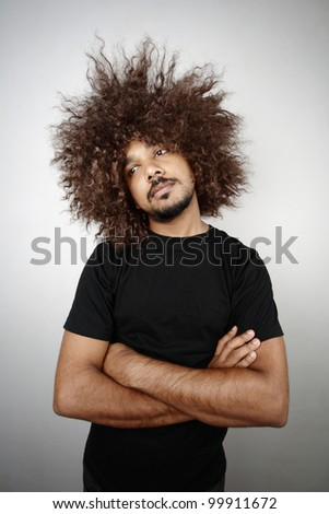 Man with funky hairstyle in a lazy mood - stock photo
