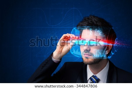 Man with future high tech smart glasses concept - stock photo