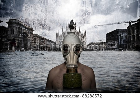 man with gas mask in a catastrophic landscape - stock photo
