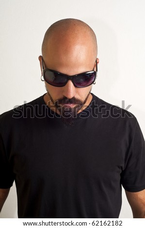 man with glasses blacks, black coat and beard, bouncer bodyguard on white background