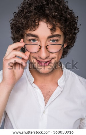 man with glasses smiling - stock photo