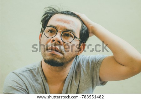 Man with glasses with the headache.