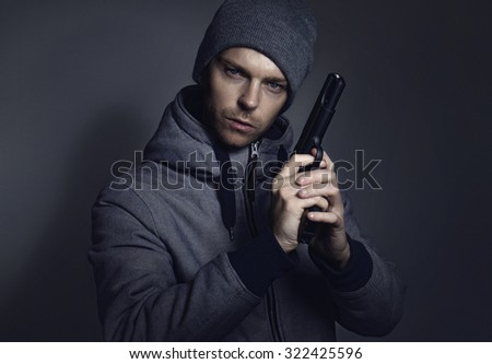Man with gun in his hand