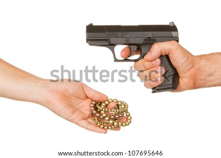 Man with gun threatening a woman to give her jewelry - stock photo