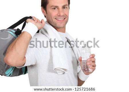 Man with gym bag - stock photo