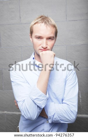 Man with hand on chin - stock photo