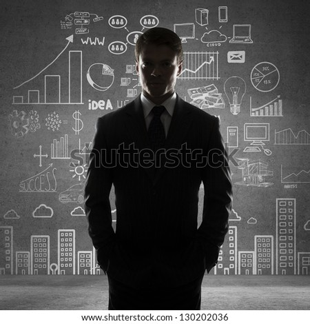 man with hands in pocket and drawing business concept - stock photo