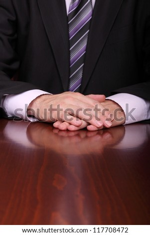 man with hands on desk is ready to listen to somebody - stock photo