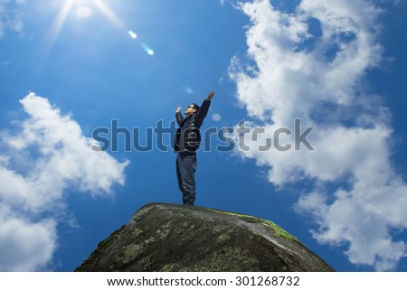 man with hands raised in the morning concept for religion, worship, prayer and praise - stock photo