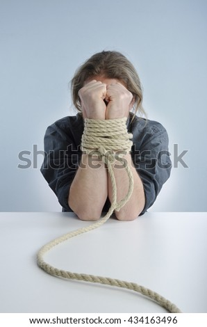 Man with hands tied - stock photo