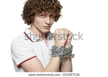 Man with hands tied by chains, isolated on white background - stock photo