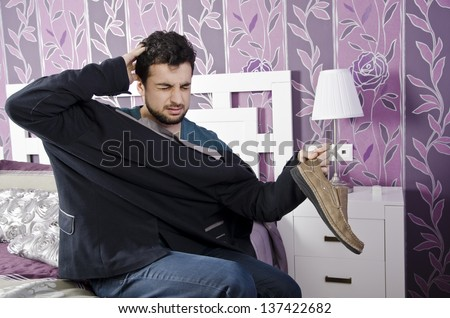 Man with Hangover and headache in the morning, confused man. - stock photo