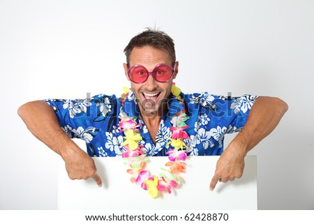 Man with hawaiian shirt on white background - stock photo