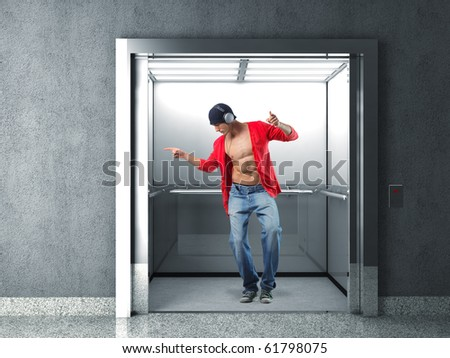 man with headphone dancing in 3d elevator - stock photo