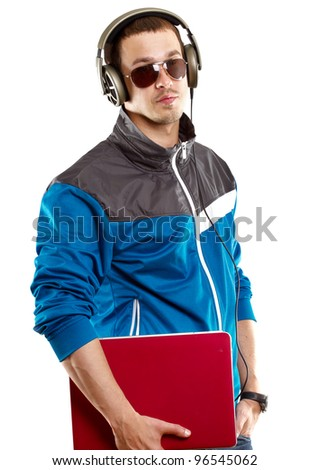 Man with headphones and laptop, listening to the music - stock photo