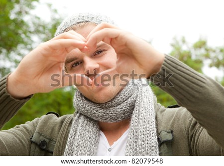 man with heartsign - stock photo