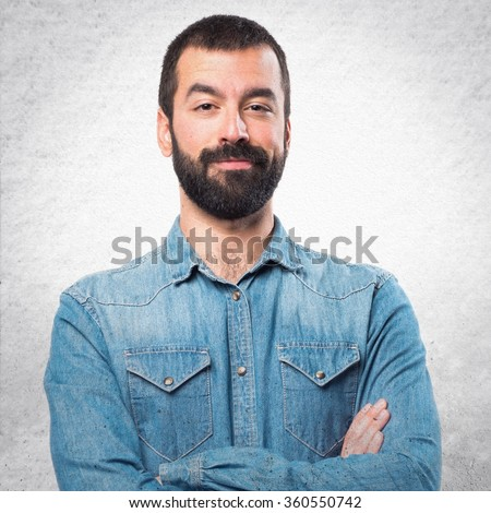 Man with his arms crossed - stock photo