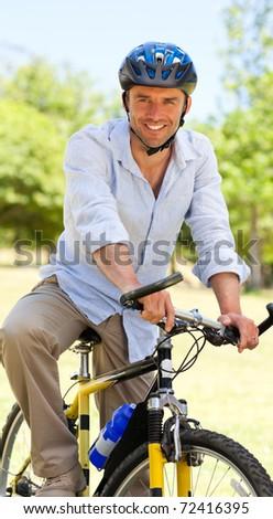 Man with his bike - stock photo